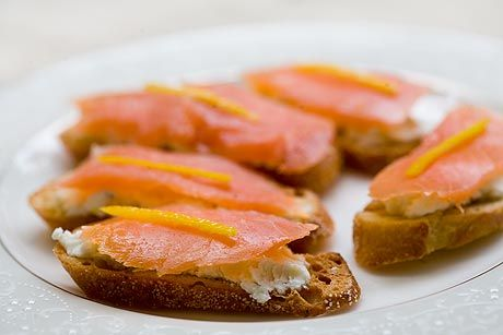 Salmon toasts recipe with smoked salmon slices over herbed goat cheese ...