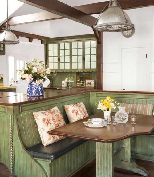 A built-in banquette offers dining space in the kitchen, where lights salvaged from a warehouse add a touch of industrial appeal.