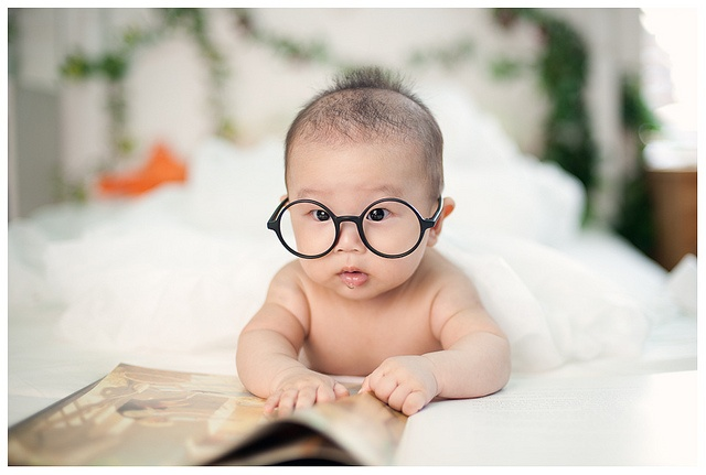 studious baby at such an early age teaching mom how to use measuring ...