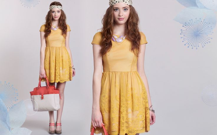 Adorable dress. Love it with the headscarf!