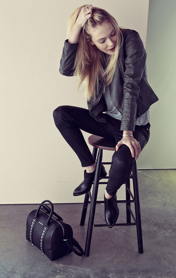 For a biker-chic look, pair coated denim with a slouchy tank and moto jacket. Then add a leather satchel and flat ankle boots.
