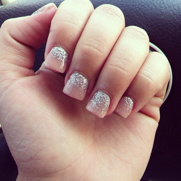 short acrylics in a warm pink color with silver glitter