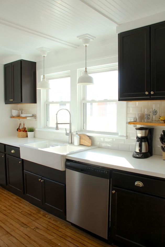 black kitchen cabinets, ikea farmhouse sink, white counters and subway
