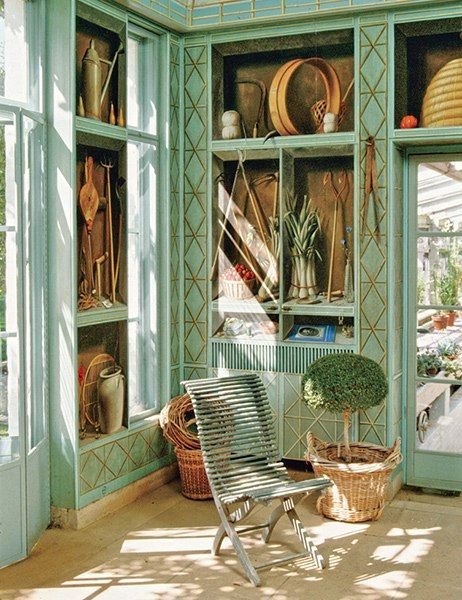 French artist Fernand Renard painted trompe l'oeil scenes on the storage cabinets that line a room at the Mellons' greenhouse complex in Virginia.
