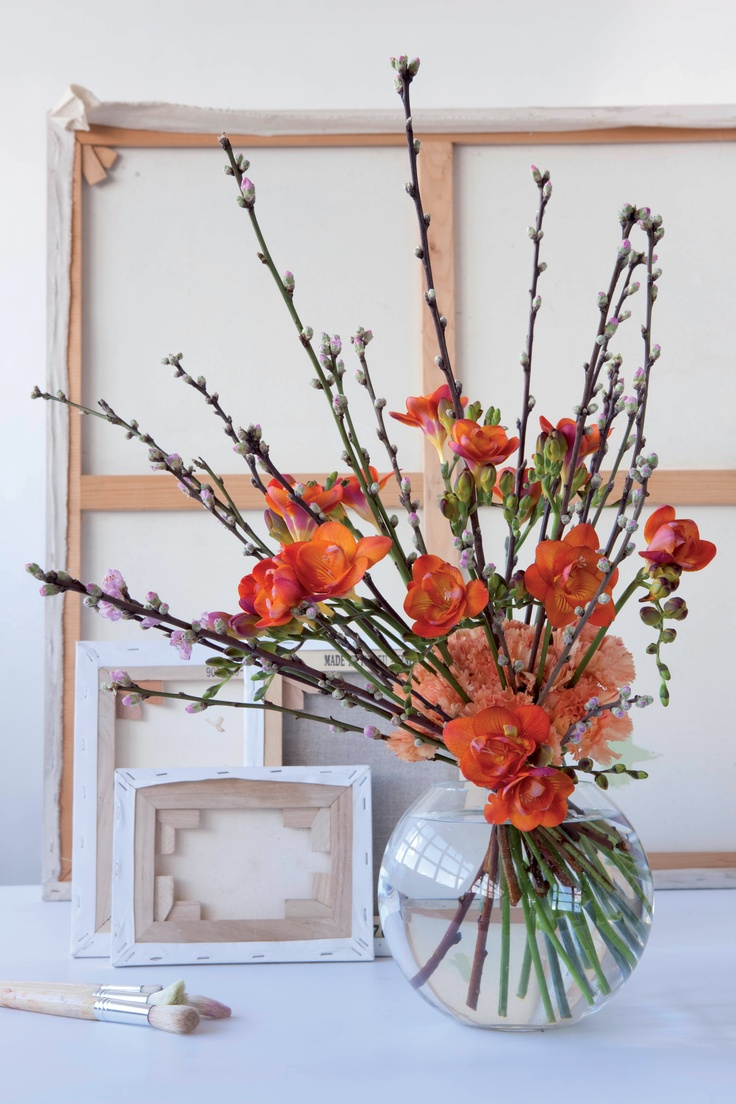 Spring has sprung fresia bouquet with spring flowers blossom