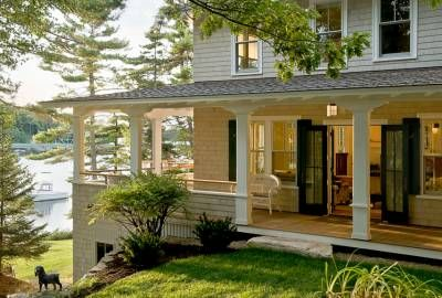 Amazing dream home. Wrap-around porch AND it's on a lake! Beautiful.