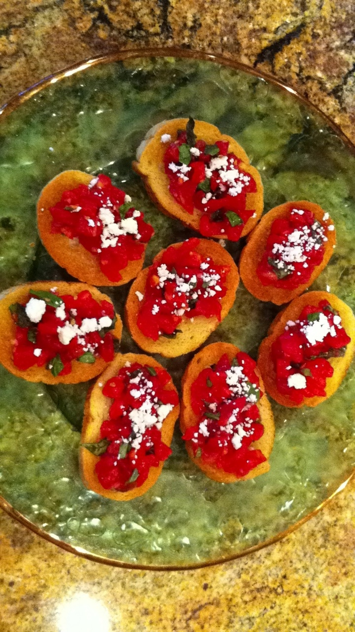 Mom's tomato basil crostini.... Deliciousness!!