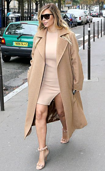 Almost four months after giving birth to North, the reality star seemed ready to strut her stuff again. Kardashian rocked a form-fitting nude-tone mini dress with thigh slit, her Max Mara wool coat, and her trusty Azzedine Alaia sandals as she strolled in Paris.