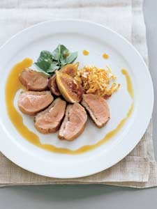 Peppered duck breast, poached balsamic figs and garlic crisps with jus ...