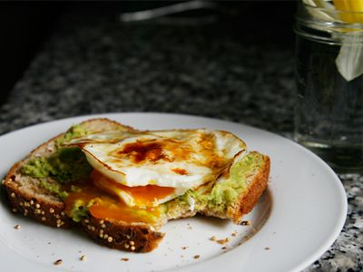 Whole grain toast with mashed avocado and an egg. :-)