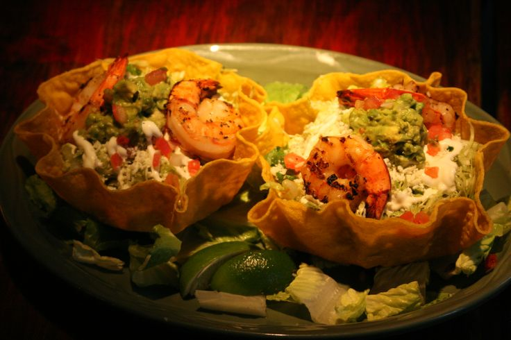 Grilled Shrimp Tostada - a large corn tortilla basket filled with a ...
