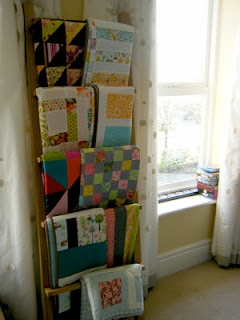 Towel rack for a quilt display