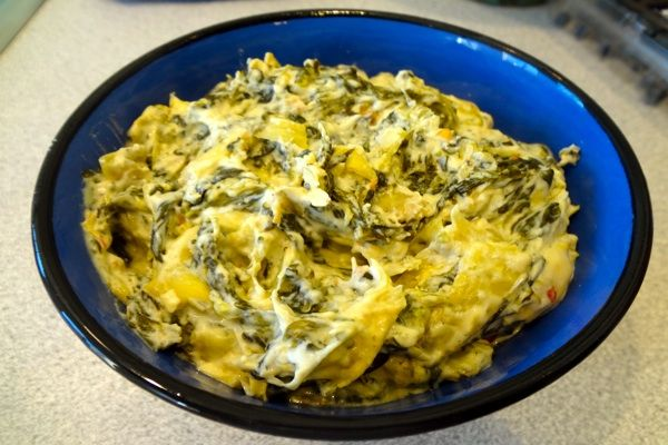 Spinach artichoke dip in a slow cooker.