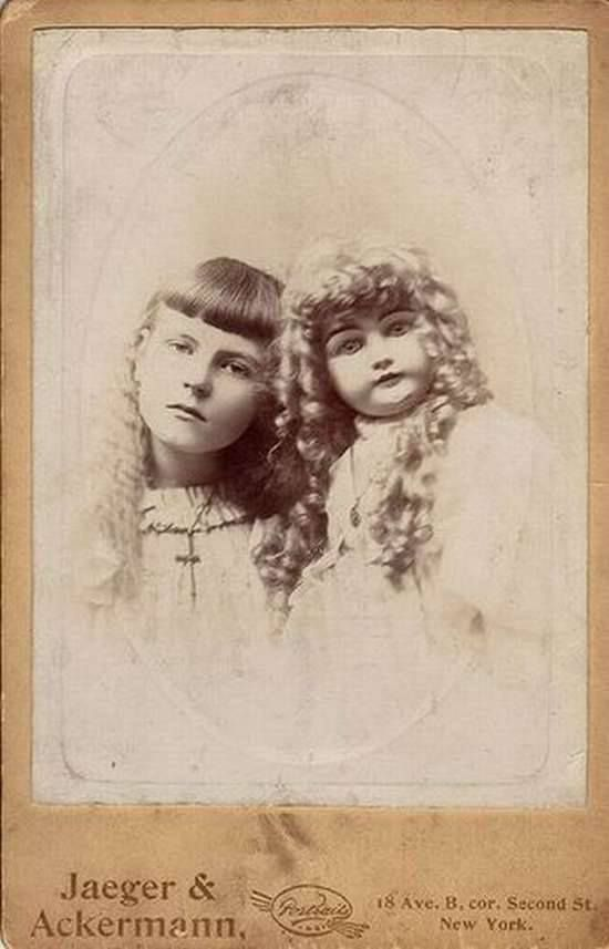 """Jane Bielawski and her doll 'Missy'. Following the suspicious deaths of some of her playmates in a New York tenement, police attempted to interview Jane. According to reports, the young girl went 'crazy' and accused her doll of the murders, before throwing the doll out of her apartment window while screaming, """"Bad dolly! Naughty dolly!"""" Jane was taken to Bloomingdale Asylum to be treated for 'hysteria'. She was never to leave the institution, dying there an old woman in 1968."""