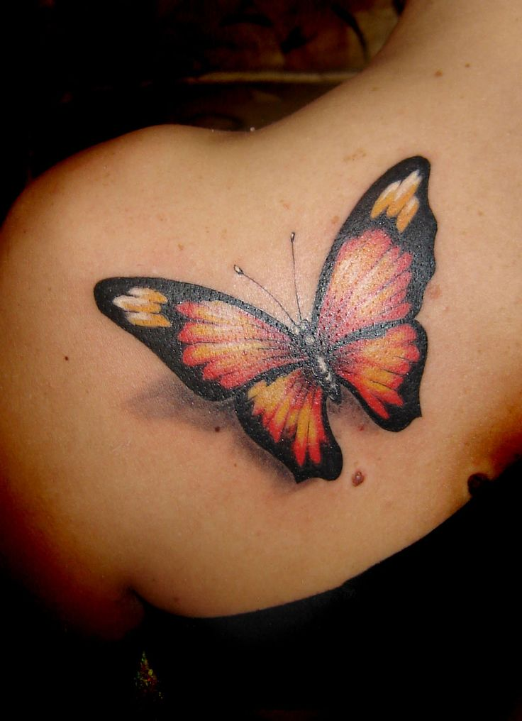 butterfly tattoo- It looks like its about to fly off of her shoulder!