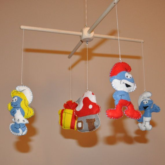 Crib mobile baby mobile nursery decoration the smurfs for Baby cot decoration images
