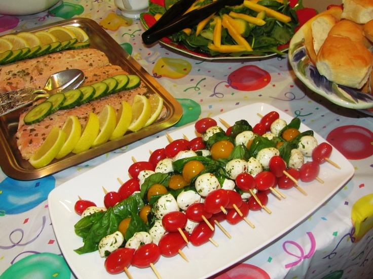 Caprese Salad skewers, poached salmon on the top left and spinach ...