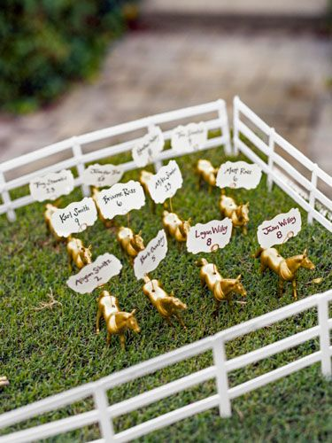 To place guests at their Kentucky wedding, this couple spray-painted plastic horses gold, drilled a small hole in each, and inserted wires to secure the cards.