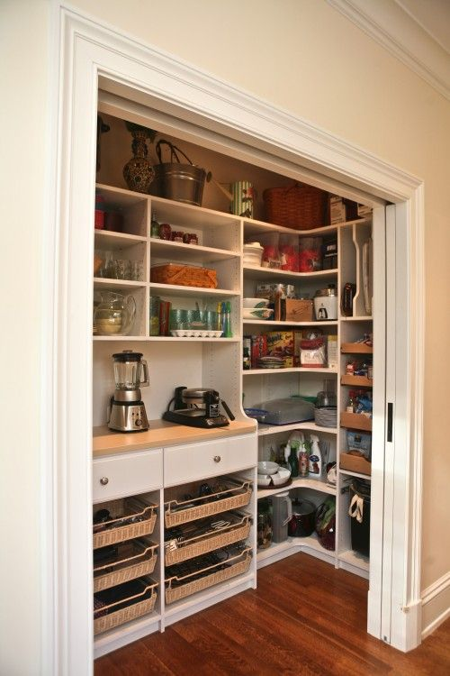 A closet for kitchen appliances. Open shelving and pocket doors to hide the clutter. I think I'm in love.
