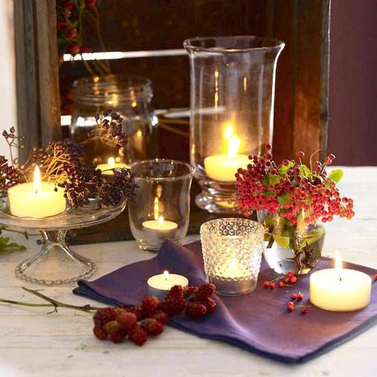 Candles centerpieces with rowan berries and rose hips