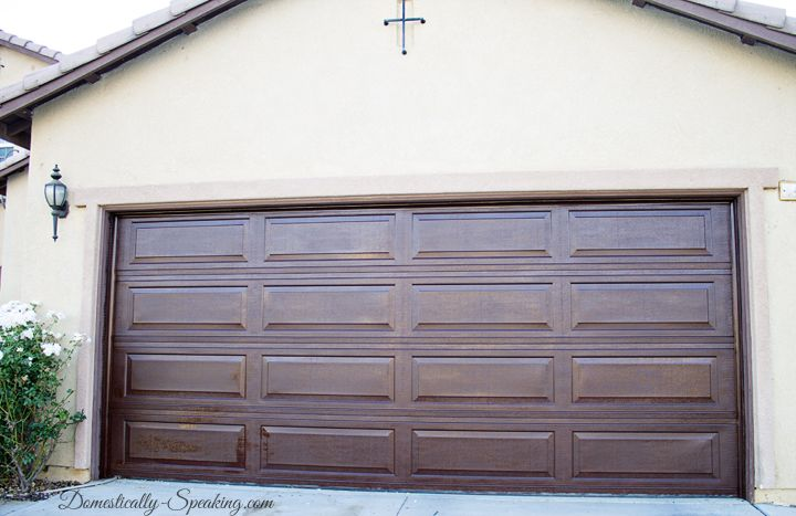Have a worn painted aluminum garage door stain it for Stained garage doors