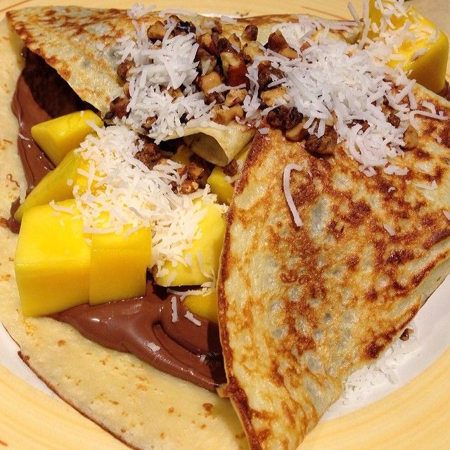 ... , via Instagram: Breakfast nutella crepe with mango, coconut and nuts