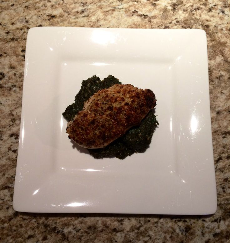 ... crusted chicken on sautéed spinach with toasted sesame & garlic