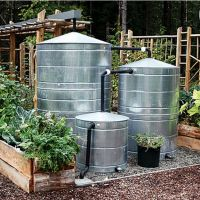 """Did you know that 1"""" of rain puts about 600 gallons of water atop a 1,000 square foot house? That's a lot of rainwater to capture and a cistern can do the trick. Captured directly from a downspout, or rain chain, a cistern will have your garden water ready. These cisterns collect rainwater from a nearby roof and when the tanks are full water is dispersed through a gravity-fed drip system that irrigates crops."""