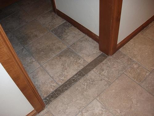 Tile vs laminate flooring for Hardwood floors vs tile
