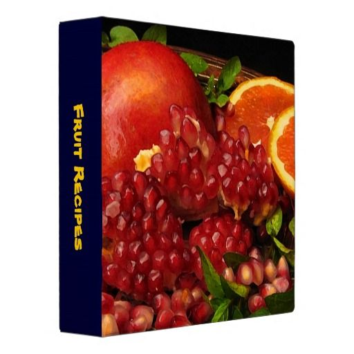 binder features a photograph of red pomegranate seeds, orange slices ...