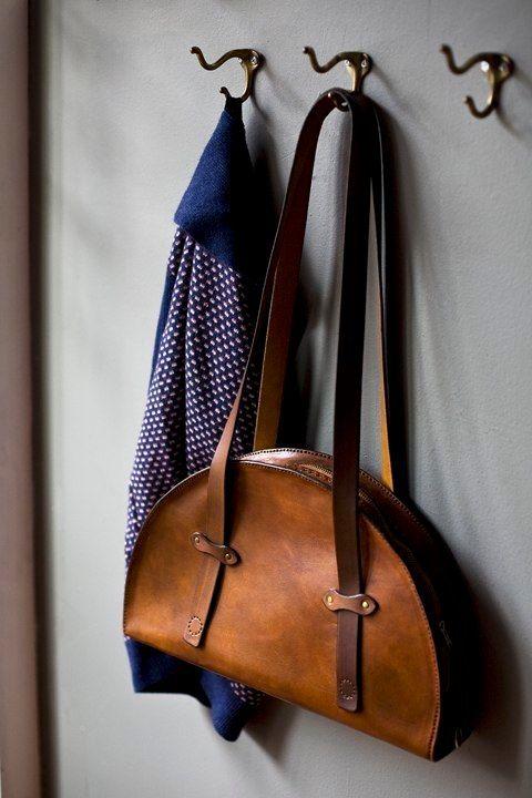 Half-moon shaped a.b.k. leather bag http://www.abknyc.com/abk.html
