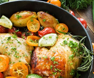 Enjoy the best of fall's produce with this roasted chicken recipe that includes apples and onions.  This looks delicious, but it looks like tomatoes in the photo instead of apples...or am I just imagining this??