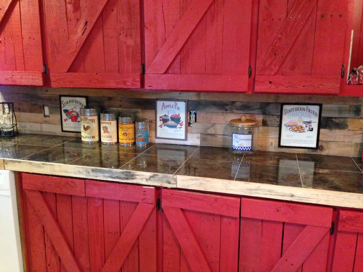 Just not red  kitchen wall & cabinets made from pallet wood