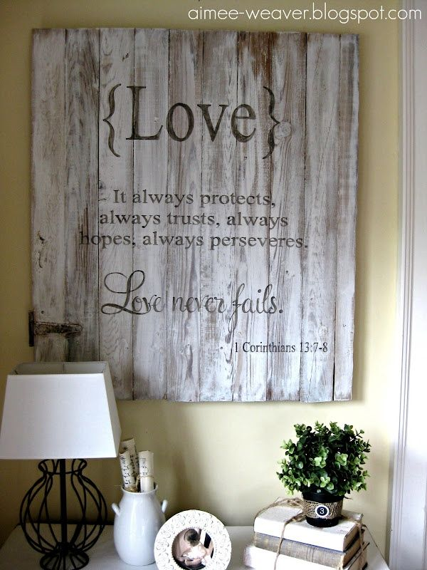 DIY Inspiration: Rustic LOVE scripture wall decoration. Use pallets or salvaged wood. Love the vintage door hardware piece in the bottom left. This would also look great with pieces of wood in varying widths. Another idea would be to take the separate width wood pieces & paint it in soft colors & distress. It would be just stunning! Would make an excellent wedding or anniversary present!!