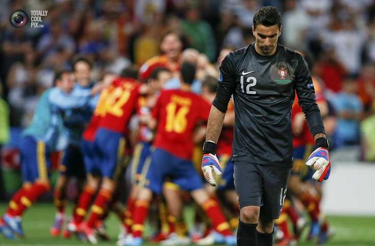Portugal's goalkeeper Patricio walks off the pitch as Spain's team celebrate their victory in the penalty shoot-out during the Euro 2012 semi-final soccer match at the Donbass Arena in Donetsk. MICHAEL DALDER/REUTERS