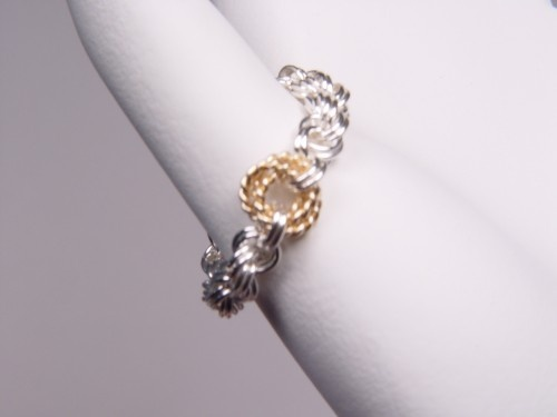 A $45 value! Beautiful sterling silver ring woven in Double Rope and accented with a twisted gold-fill love knot! Here's your chance to win one - just re-pin to one of your boards! Winner will be announced here!
