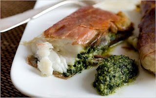 """Super easy and quick """"prosciutto wrapped tilapia"""" with pesto...look..."""