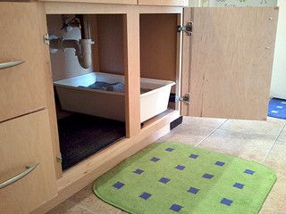litter box under the sink small urban apartment rental