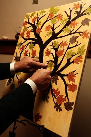 Neat guest book idea! Paint a bare tree and have leaf cut outs for guests to sign then have them attach them to the tree.