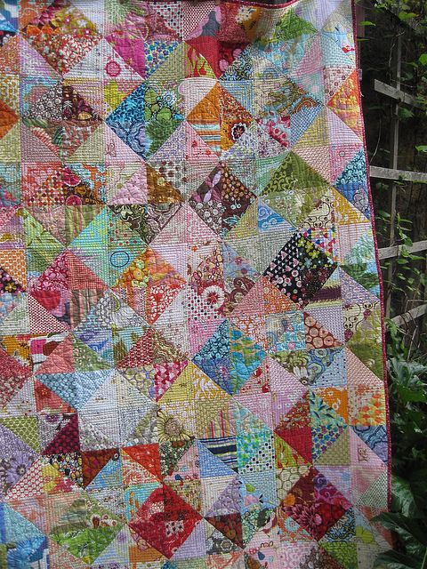 Scrappy quilt - pattern comes from arrangement of lights and mediums/darks.  Very nicely done.