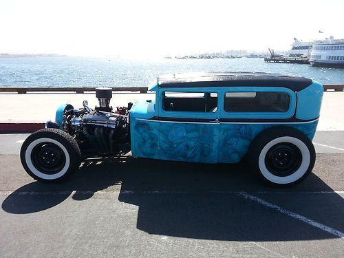 Blue hotrod by the ocean