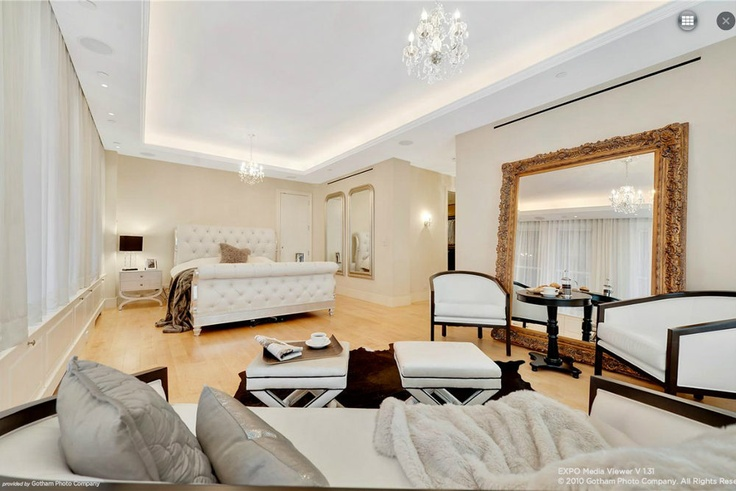 bedroom love. giant mirror that's gold & gilded. tufted bed. and it's huge.
