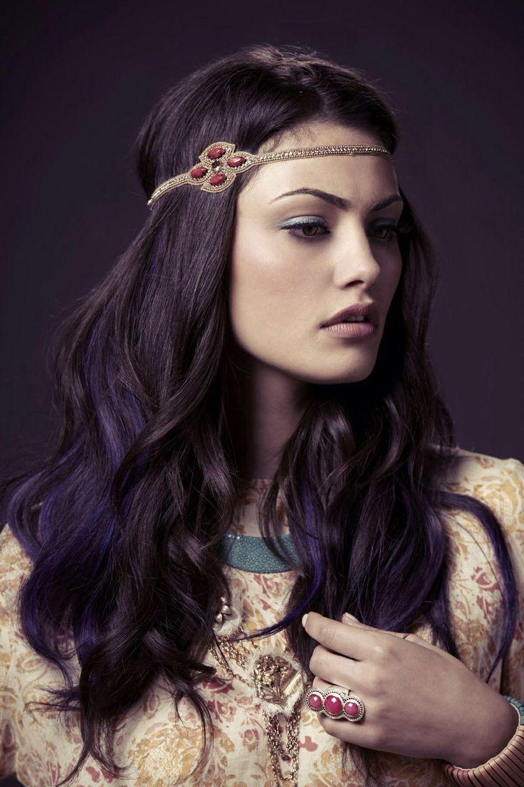 Dark purple lowlights on dark hair.