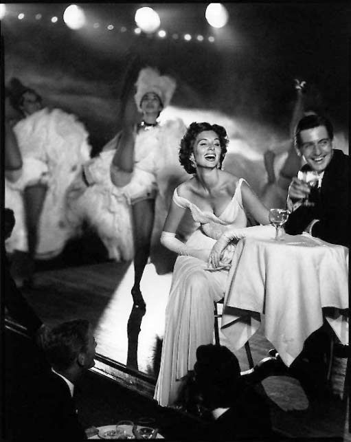Suzy Parker and Robin Tattersall. Evening dress by Gres, Moulin Rouge, Paris, August 1957