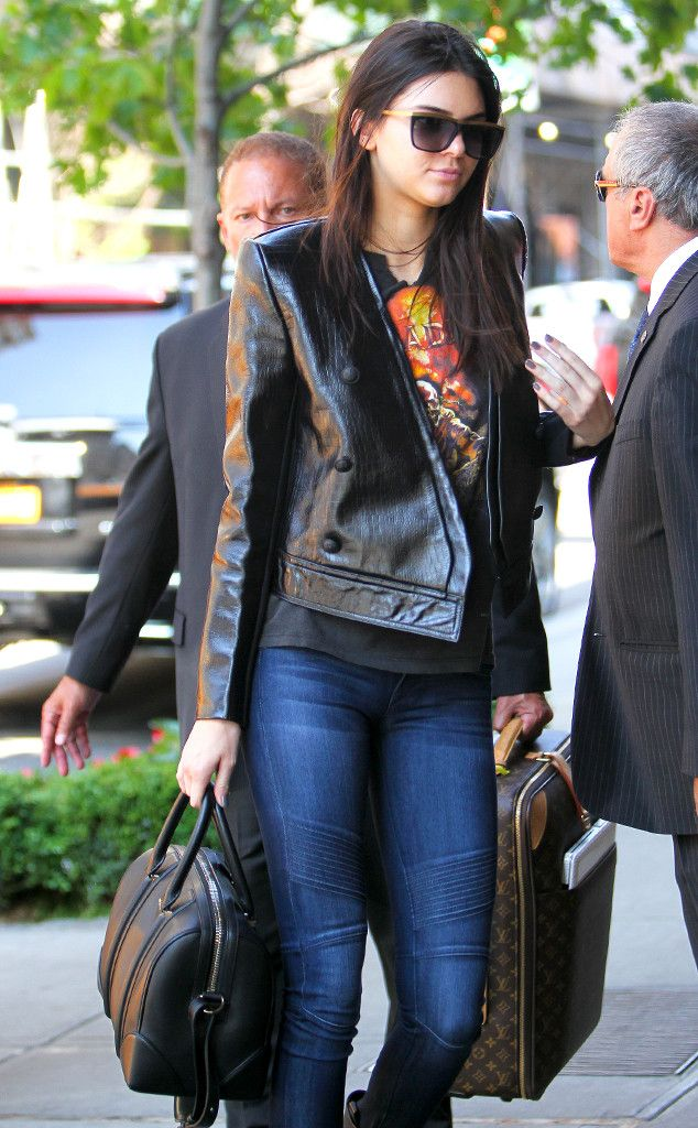Kendall Jenner revealed her edgy side in a badass leather jacket, biker jeans and flat-top sunnies with a gold browline!