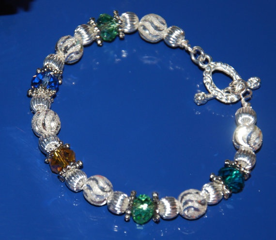 Beautiful Mothers or Grandmothers silver birthstone bracelet with swarovski stones.  Great Mother's Day gift!