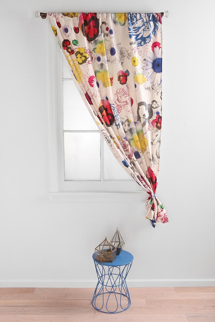 Floral curtain, short and small window just like bonus room.