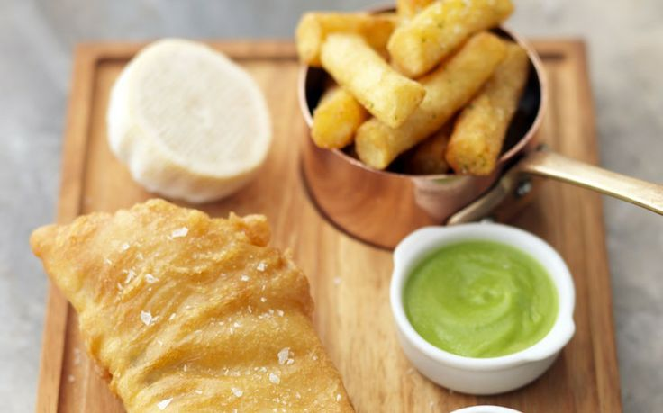 Beer-battered fish and chips with homemade tartar sauce and pea purée ...