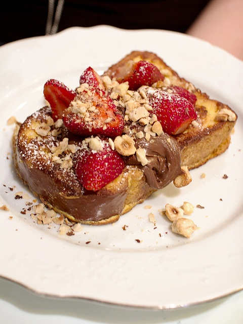 Fried Brioche with nutella, strawberries and roasted hazelnuts