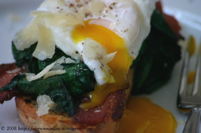 poached eggs over wilted spinach and bacon on toast. going to add an ...